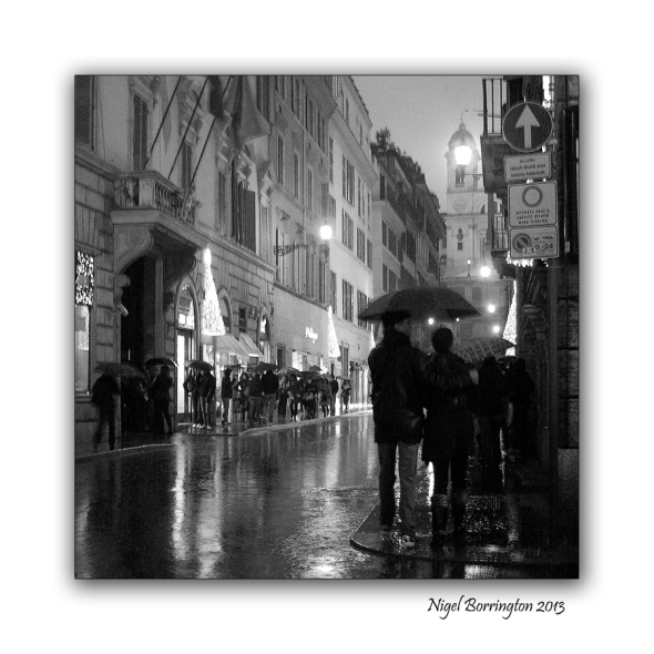 Shopping at Via Condotti  rome in the rain