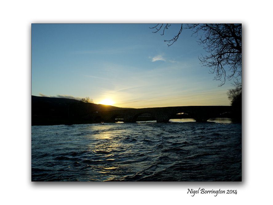 Changing light of the river flow